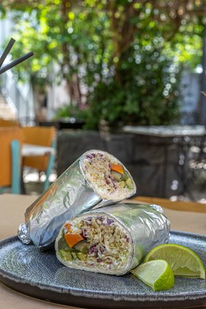 """Brunch Menu Tortilla wrap with bulgur, cabbage, """"tsalafouti""""cheese, roast vegetables, fresh onions and lime"""