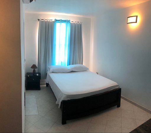 Habitación doble, con baño privado, aire acondicionado y televisión