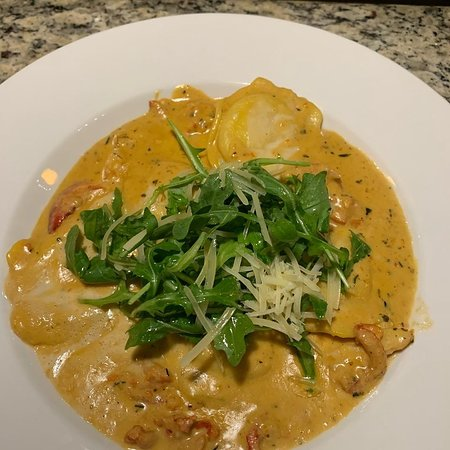 LOBSTER RAVIOLI  -  Chef's choice Maine Lobster stuffed Ravioli topped with Lobster meat in Bisques Reduction sauce