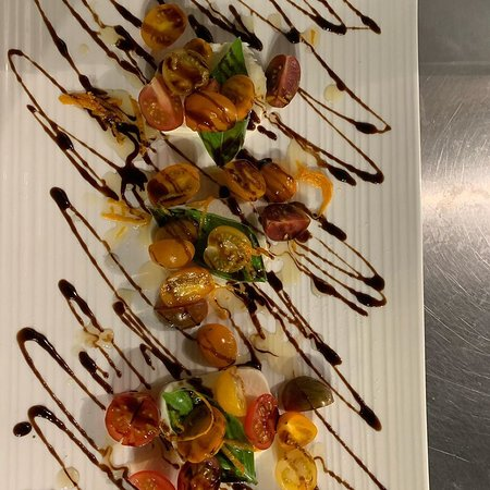 BUFFALO CAPRESE  -  Creamy Buffalo Mozzarella, fresh sliced Heirloom Tomato, topped with Florida Orange Vinegar Reduction