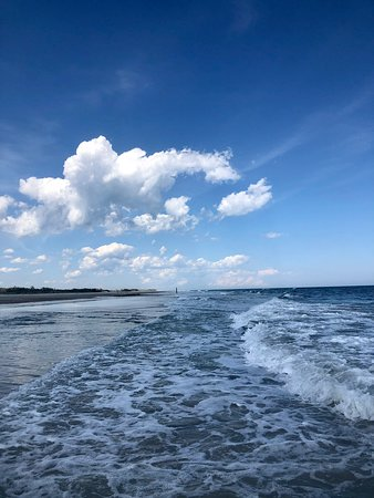 This picture is taken from the beach side of the 'elbow' sandbar less than a 10 minute boat ride from the marina we launch our rentals from. Once you anchor up, this is a short walk away to feel worlds away! Beautiful!