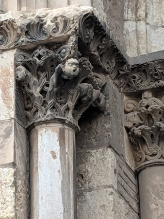Stone figures on top of door columns at entrance to Saint Sernin.