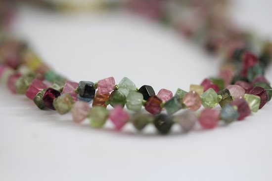 Greystones, Ireland: Multicoloured tourmalines in this 3 strand necklace with handmade gold catch.