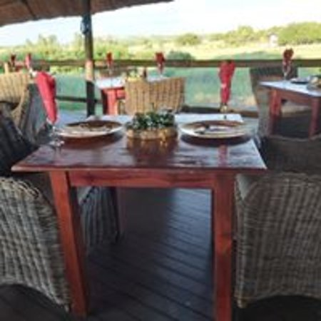 Breakfast Area - on a wooden deck and overlooks the watering hole