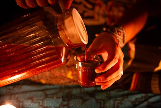 Pouring the Sacred and Mystical Ayahuasca Brew.