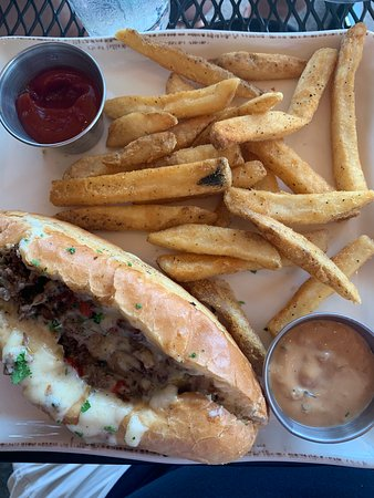 A very good cheesesteak sub with homemade fries.