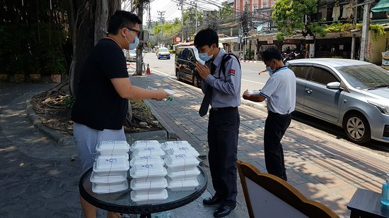 Our boss giving out packed food to the less fortunate.