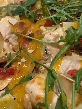 Mmmm sweet chix pizza free-range chicken on a sour cream base, mushroom, capsicum, caramelised leek & onion, topped with greens, toasted almonds, & apricot sauce YUMMY!!