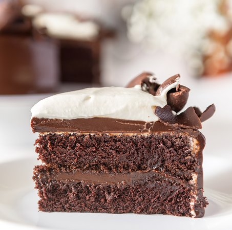 Our To Die For Chocolate Cake (TDFCC) is an irresistible combination of chocolate cake layered and covered with chocolate ganache and topped with whipped cream and chocolate shavings