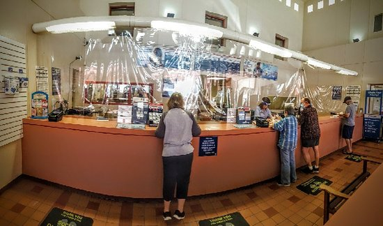 The Yucaipa US Post Office is making safe and healthy for all its customers with social distancing signs,staffwith masks and lucite shields.
