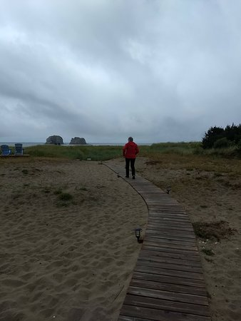 Private boardwalk out to beach for guests of motel