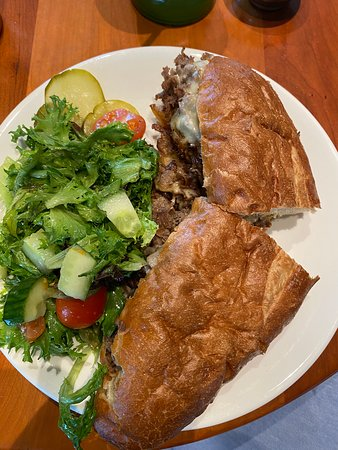 Philly cheesesteak and green salad with lemon vinaigrette dressing