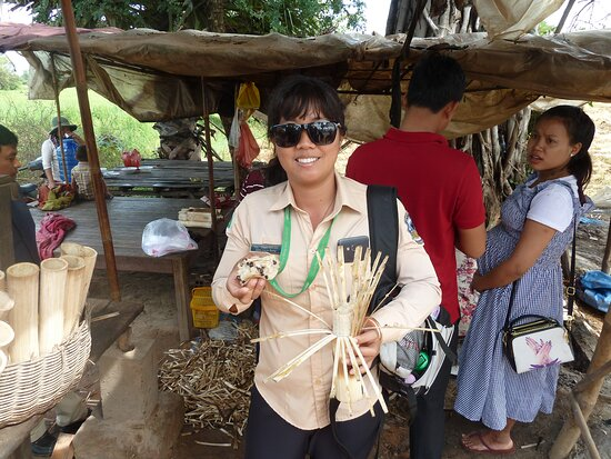 Sun introducing roasted sugar cane at a roadside stand on road to lake Tonie Sap