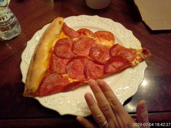 Owasso, OK: One slice of the 20-inch pizza