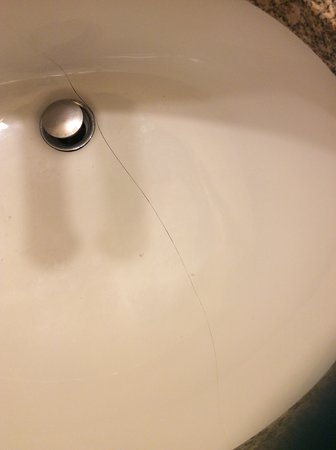 Sink cracked all the way across in master bathroom