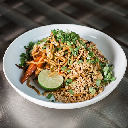 Udon Noodle Stir Fry. Our delicious Udon Noodle Stir Fry. Bok choy, roasted carrot, Pebble Creek mushrooms, green beans, udon noodle, sweet and spicy brown sauce, scallions, peanut, and lime. Add smoked brisket, steak, or chicken for a small upcharge.
