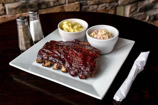 Champaign, IL: Our fresh smoked ribs with our house made potato salad and coleslaw!