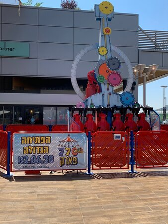 This amusement park apparatus is directly in front of the restaurant. I suggest that you go on this before- and not after- eating.