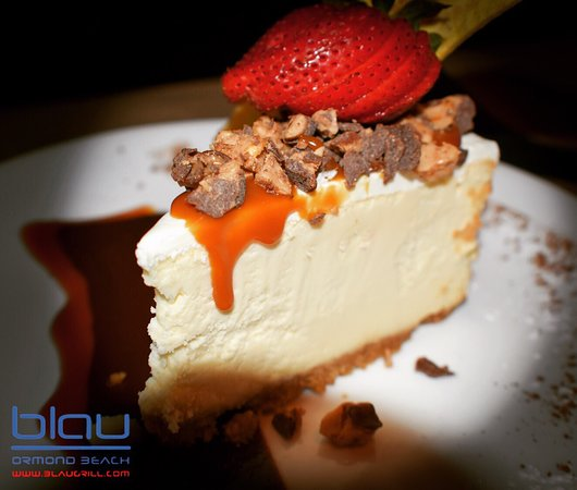 NY style Cheese Cake, topped w/ crumbled Heath Bar crunch candy. Served w/ chocolate & caramel drizzles.
