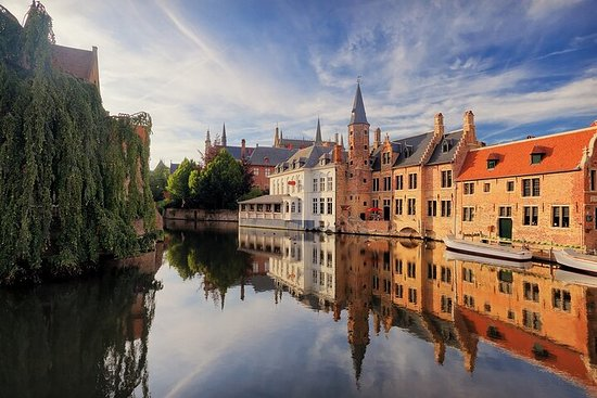 Explore Bruges UNESCO heritage city on a private tour with scenic...