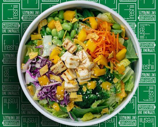 Zen Salad Spinach 'n Romaine, Tofu, Cabbage, Carrots, Broccoli, Edamame, Mango, Tortilla Strips, Sesame Seeds, and Asian Sesame Dressing.