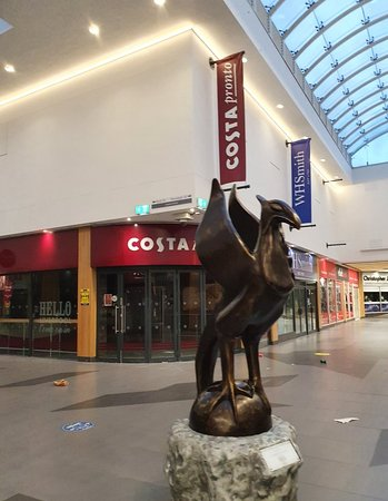 Statue outside Costa Coffee in Liverpool Central Railway Station.