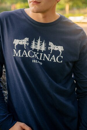 This is our Long Sleeve T-shirt with signature horse and tree graphic. Breath easy in this 100% cotton, Signature long sleeve T-shirt. Our new Signature styles evokes #PureMackinac Island nostalgia. Inspired by woodcut designs from the past, this long-sleeve T-shirt's design embraces the history that makes Mackinac Island what is today.