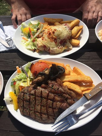 steak / chicken new yorker both with chunky chips and salad + side saw. delish