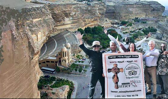 Happy Travelers lifting the poster of Tamer Mina