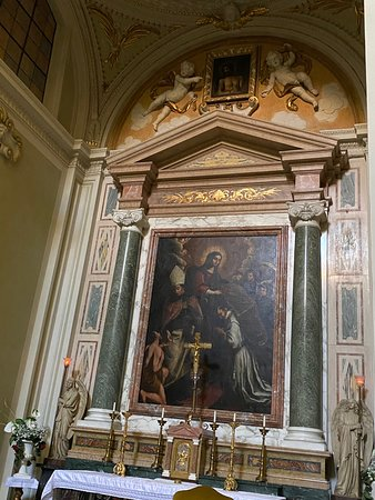 High altar - The altar aedicule is against the far wall of the apse, and has a pair of green marble Ionic columns. The altarpiece shows the two Spanish saints Ildephonsus of Toledo and Thomas of Villanova with Our Lady.