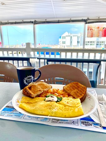 Oves Restaurant - Breakfast Omelet served with a cup of coffee.
