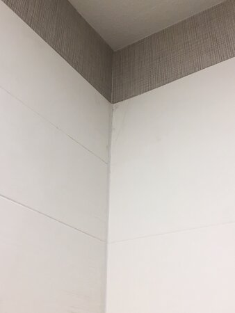 The hotel was poorly constructed, and there was even a broken tile installed in the shower.