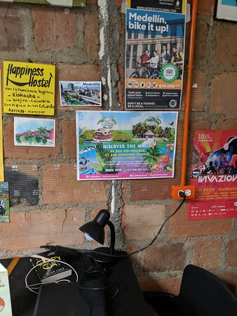 Information posters on the wall at the Panela Hostel.