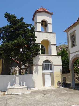 The bell tower of the Church of the Assumption of the Virgin in Kornos village - Lemnos, Greece