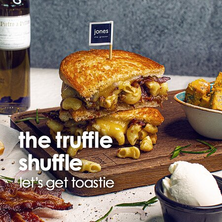 The Truffle Shuffle Toastie  We all love ourselves a cheesy bowl of mac n cheese. But have you ever had it in a buttered, crisp toastie with decadent fig & pomegranate jam and smoked beef bacon? We know - YUM! Come on over and take a bite out of the Truffle Shuffle or order it from our website. #jonesuae #letsgettoastie  #gourmetfoodforeverydayliving