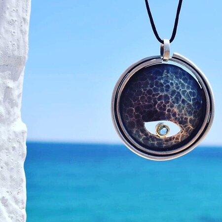 Handmade silver and gold neckpiece with blue topaz by a Greek designer.