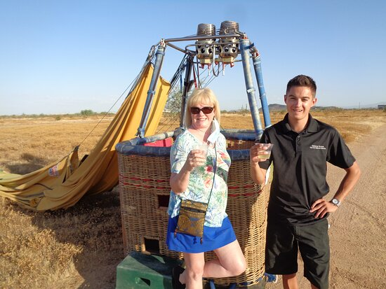 Phoenix Hot Air Balloon Ride at Sunrise: Back on the ground enjoying a post flight drink of champagne.