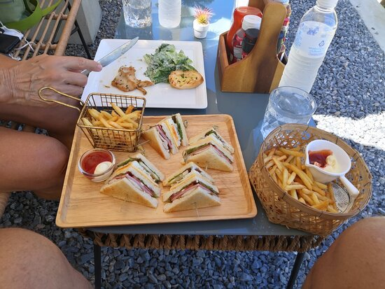 Cesar Salad, snd a Club Sandwich, both with French Fries