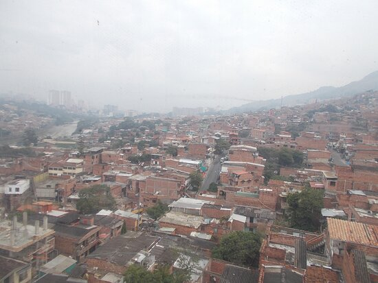 """The """"brick houses"""" down below which is about the bottom of a hillside (during about a 10-minute cable car ride from Acevedo to Santo Domingo)"""