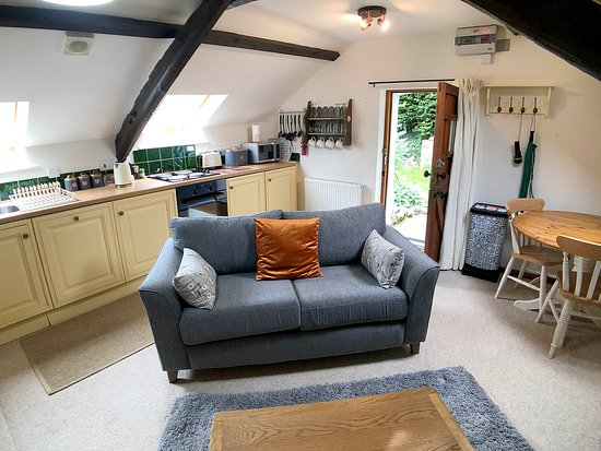 Red Kite Cottage open plan living room. Built in oven, hob, fridge, freezer and dishwasher in kitchen.