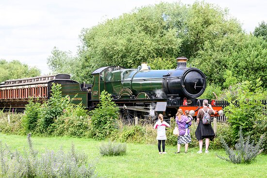 """Enthusiastic visitors watch locomotive 2999 """"Lady of Legend"""" and a train of magnificently restored vintage carriages at Didcot Railway Centre"""