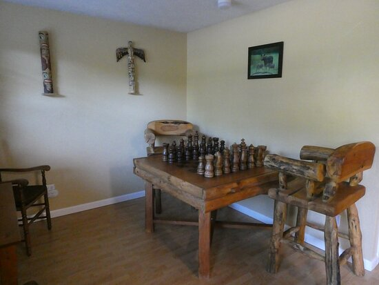 There is a huge chess set outside the breakfast area.