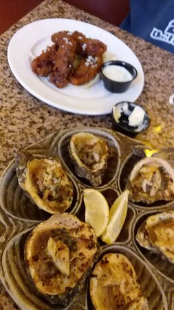 charbroiled oysters with crab meat and alligator wings