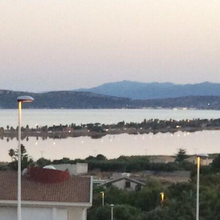 Sardegna Cagliari Poetto al calar del sole con mare fermo