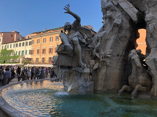 Detail from the Bernini's 16th century marble fountain, Fountain of Four Rivers, which is in the centre of the piazza.