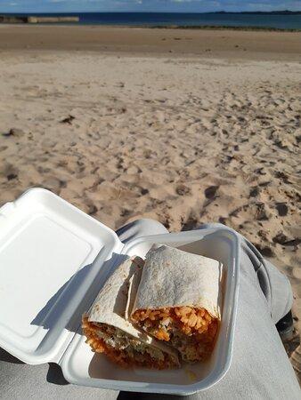 Fish burrito with sea view.