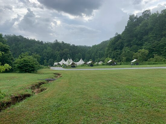 The campground surrounded by mountains and covered in clouds