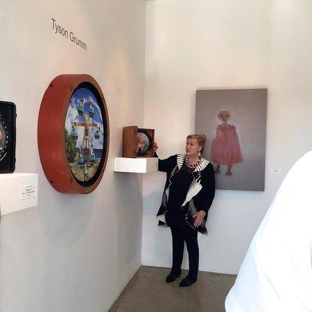 Owner Sue Greenwood with artist Tyson Grumm artworks.