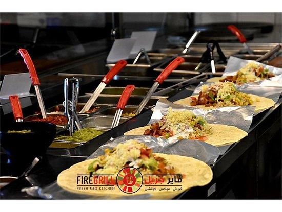 FireGrill: 4 beautiful burritos in the making. 🔥