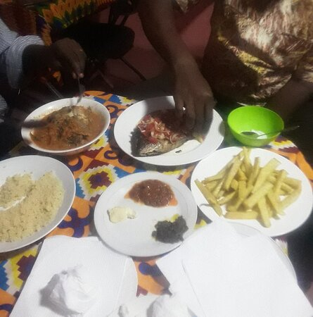 Amazing Pepper Soup of Tilapia and Attiéké (couscous of Cassava) and Grilled tilapia with Fried Yam It's Yummy!